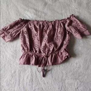 A dusty rose blouse